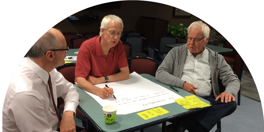 Three men working through Foundation Program-type content from Centre for Holding Space